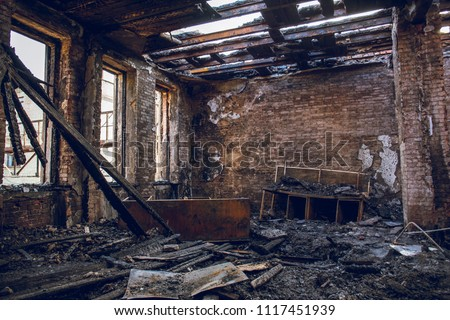 Burned house interior after fire, ruined building room inside, disaster or war aftermath concept #1117451939