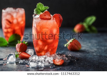 Fresh strawberry cocktail. Fresh summer cocktail with strawberry and ice cubes. Glass of strawberry soda drink on dark background. #1117463312