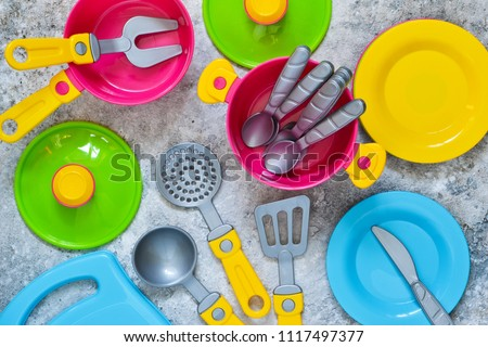 Kids toys. Children's tableware for the game. #1117497377