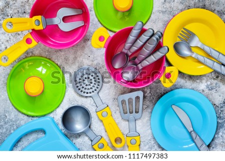 Kids toys. Children's tableware for the game. #1117497383
