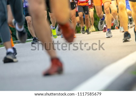 Chiang Mai, Thailand - June 17th, 2018 : Group of Chiang Mai people feet running in marathon running race on June 17th, 2018 in Chiang Mai Thailand #1117585679