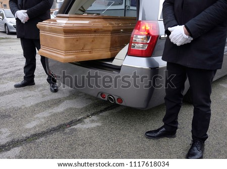 coffin inside funeral wagon #1117618034