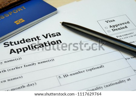 Student Visa application form with passport and pen. Document with passport, apply and permission for foreigner country #1117629764
