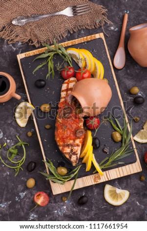 fish with lemon tomato and amazon sauce #1117661954