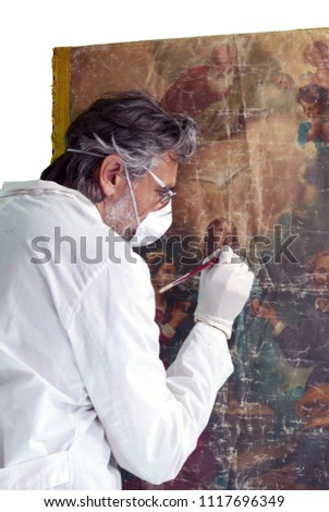 restorer working on oil painting  over white background