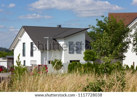 garden fence of modern house architecture in rural countryside at springtime in south germany near city stuttgart #1117728038