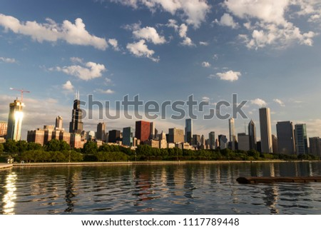 CHICAGO, ILLINOIS, USA – JUNE 15, 2018:  The skyline of downtown Chicago on an early summer morning, as viewed from the Lakefront Trail near Adler Planetarium and Shedd Aquarium. #1117789448