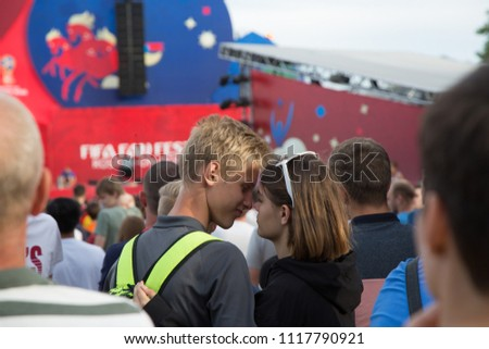 Rostov-on-Don/Russia - 06 17 2018: Couple kissing in a crowd of football fans #1117790921