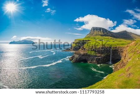 Gasadalur village and Beautiful  waterfall, Sunny Day, Vagar, Faroe Islands, Denmark.  Royalty-Free Stock Photo #1117793258