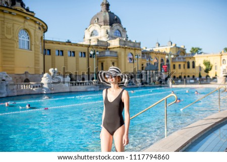 HUNGARY, BUDAPEST - MAY 21, 2018: Young woman relaxing at the famous Szechenyi thermal bathes one of the biggest natural hot spring spa baths in Europe #1117794860