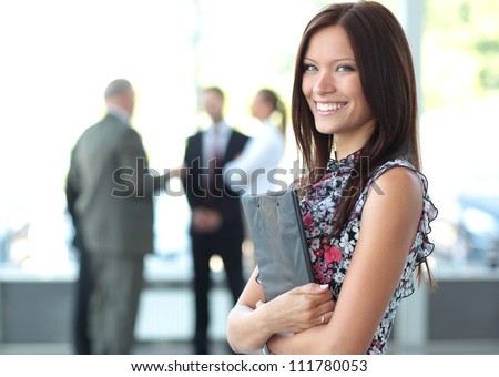 Face of beautiful woman on the background of business people #111780053