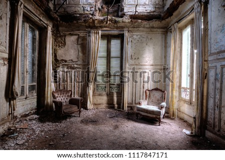 Chairs in an abandoned room in france Royalty-Free Stock Photo #1117847171