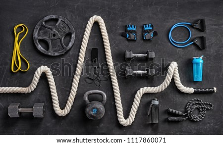 Sports equipment on a black background. Top view. Motivation #1117860071