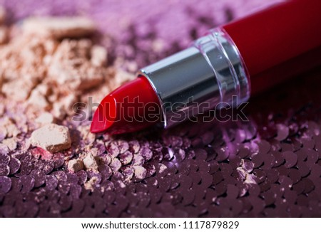 Female handle a lipstick on hand #1117879829