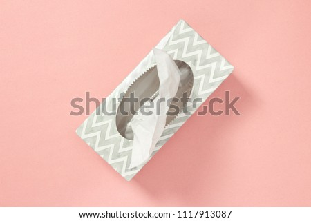Gray tissue box on pastel pink background. Healthcare and hygiene. Royalty-Free Stock Photo #1117913087
