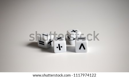 Four white dice with mathematical math symbols. #1117974122