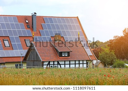 Solar panel on a red roof - renewable alternative energy source in countryside at northern of Germany #1118097611