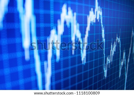 World economics graph. Abstract financial background trade colorful. Macro close-up. Stock market chart on LCD screen. Finance business data concept. Stock analyzing.