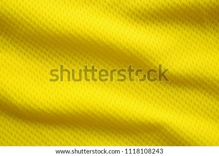 Yellow color football jersey clothing fabric texture sports wear background, close up #1118108243