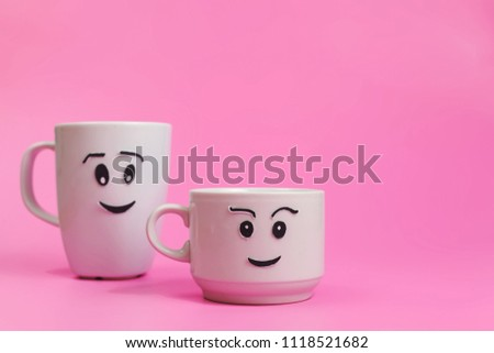 Two funny cups on pink background. Concept about relationship and love. #1118521682