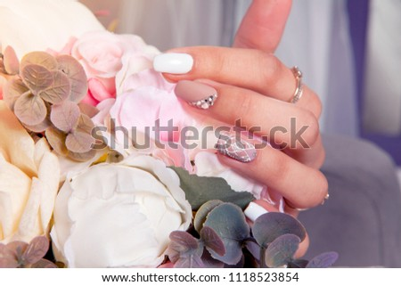French wedding manicure with flowers and beads #1118523854
