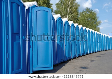 A line of portable toilets. #1118843771
