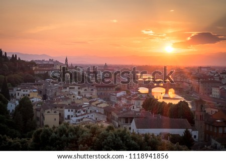 Florence during golden hour of sunset with Oltarno to the left #1118941856