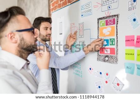 Designers man drawing website ux app development. User experience concept. #1118944178