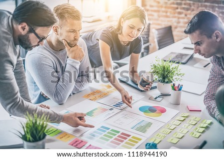 Business people meeting at office and use post it notes to share idea. Brainstorming concept. Sticky note on glass wall. #1118944190