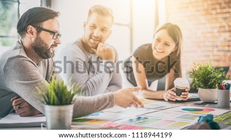 Business people meeting at office and use post it notes to share idea. Brainstorming concept. Sticky note on glass wall. #1118944199