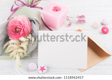 Open empty greeting card with bouquet and pink buttons #1118962457