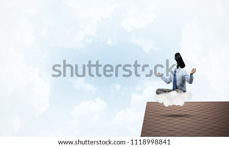 Faceless businessman with camera zoom instead of head sitting in lotus pose #1118998841