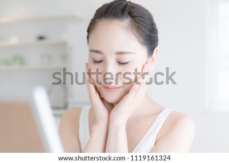 Skin care concept. Young asian woman checking her skin. #1119161324