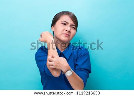 Woman scratching her skin #1119213650