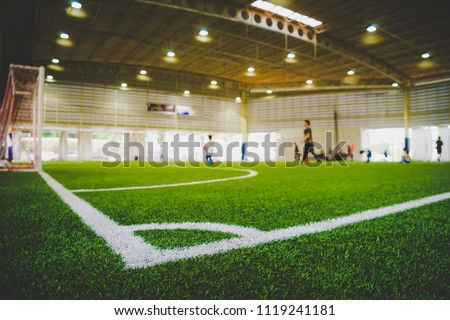 Corner Line of an indoor football soccer training field in Junior Soccer Academy school with blurred children and coach practicing on the background #1119241181