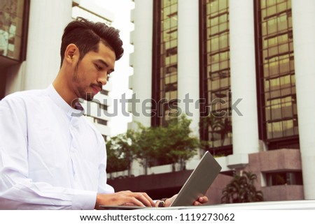 Business man working outdoor and offices building background. #1119273062