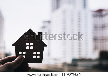 House model in home insurance broker agent 's hand or in salesman person. Real estate agent offer house, property insurance and security, affordable housing concepts #1119279860