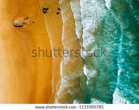 Aerial Panoramic Drone View Of Blue Ocean Waves And Beautiful Sandy Beach in Portugal #1119300785