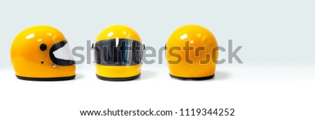 Yellow motorcycle helmet on a white background, front, back, side Royalty-Free Stock Photo #1119344252