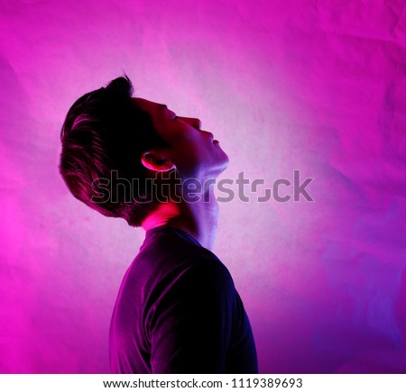 Silhouette of a man deep in thought. A side view of a person who is seriously concerned. #1119389693