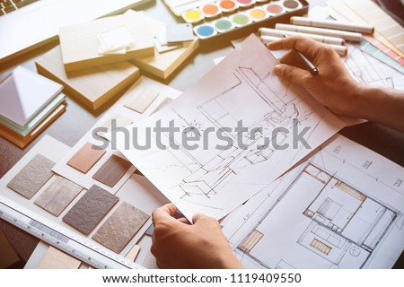 Architect designer Interior creative working hand drawing sketch plan blue print selection  #1119409550