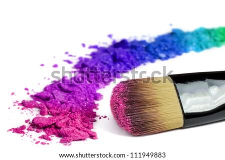 Professional make-up brush on rainbow crushed eyeshadow Royalty-Free Stock Photo #111949883