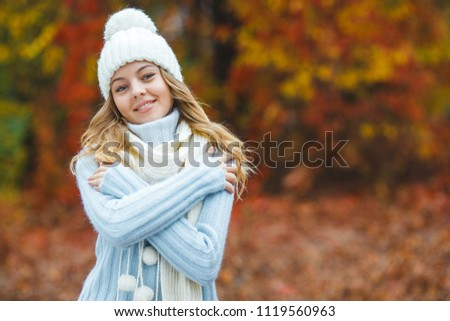 Young attractive woman in autumn colorful background #1119560963