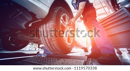 Automotive suspension test and brake test rolls in a auto repair service. Background Royalty-Free Stock Photo #1119570338