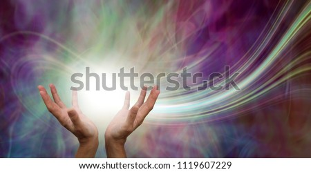 Stunning Healing Energy phenomenon  - female hands reaching up into a ball of white  energy with a laser trail and pink green ethereal energy field  background  #1119607229