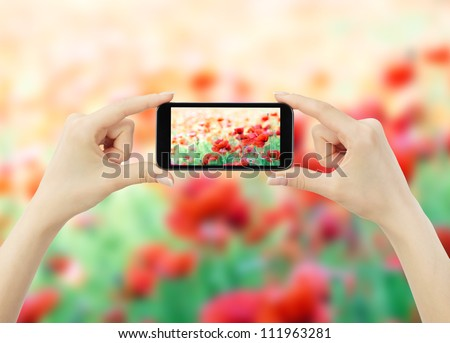 woman taking photo with mobile cell phone