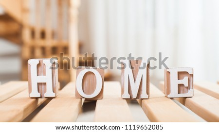 Word home of the decorative letters on wooden table #1119652085