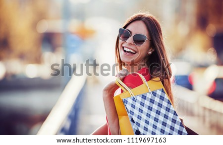 Woman in shopping. Happy woman with shopping bags enjoying in shopping. Consumerism, shopping, lifestyle concept #1119697163