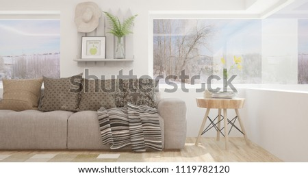 White room with sofa and winter landscape in window. Scandinavian interior design. 3D illustration #1119782120