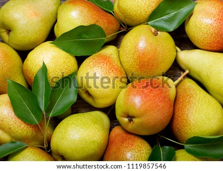 fresh pears with leaves as background, top view #1119857546